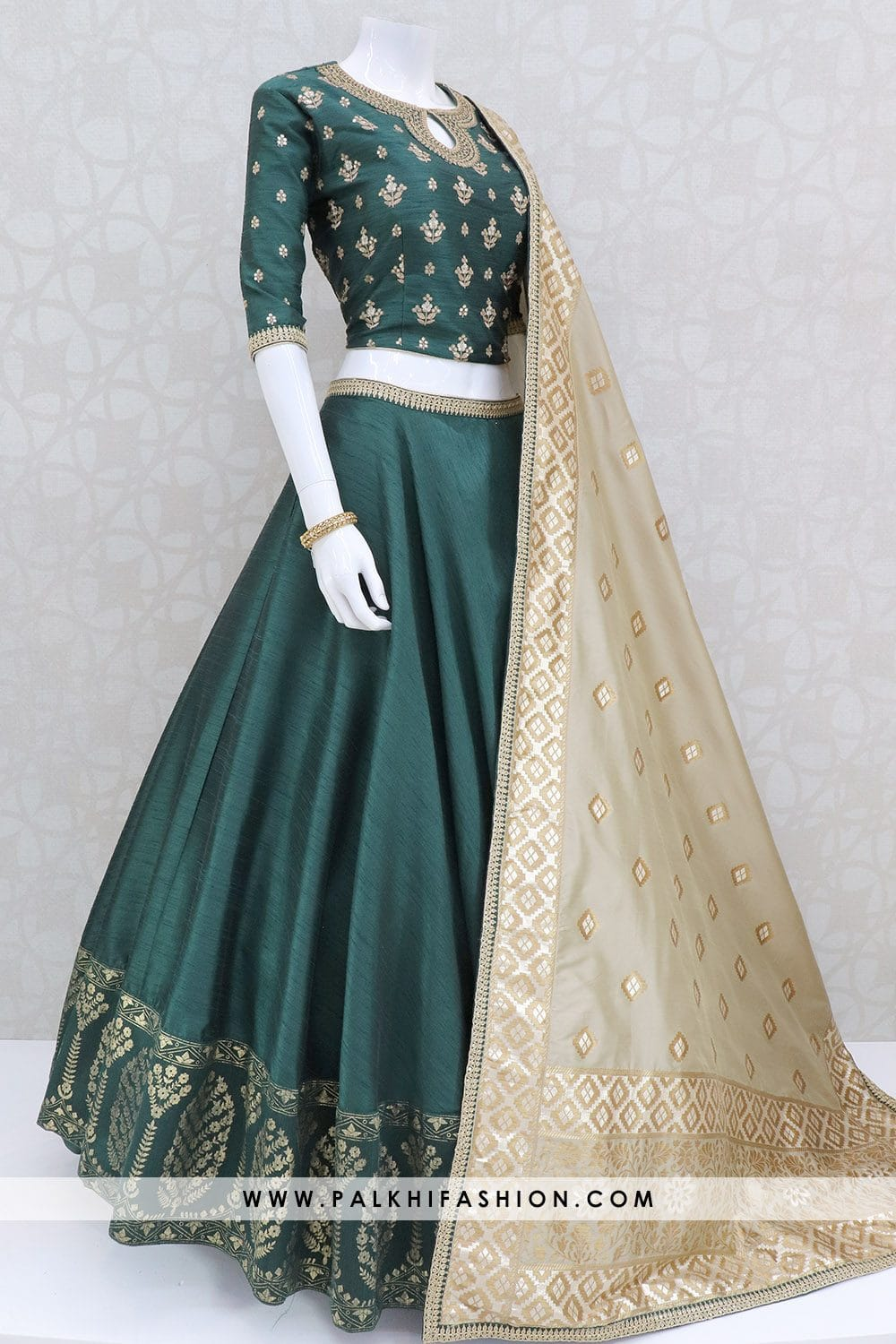 Dark green full flair designer lehenga choli from palkhi fashion with silk embossed designs.silk blouse with embroidery & gold full size pure silk dupatta