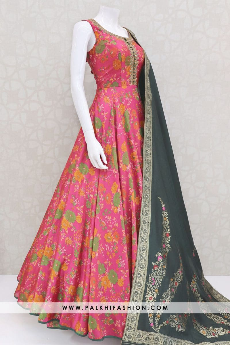 Dark pink designer soft silk indian outfit from palkhi fashion with floral prints.Top enriched with petite stone,kundan work.dupatta with attractive prints.