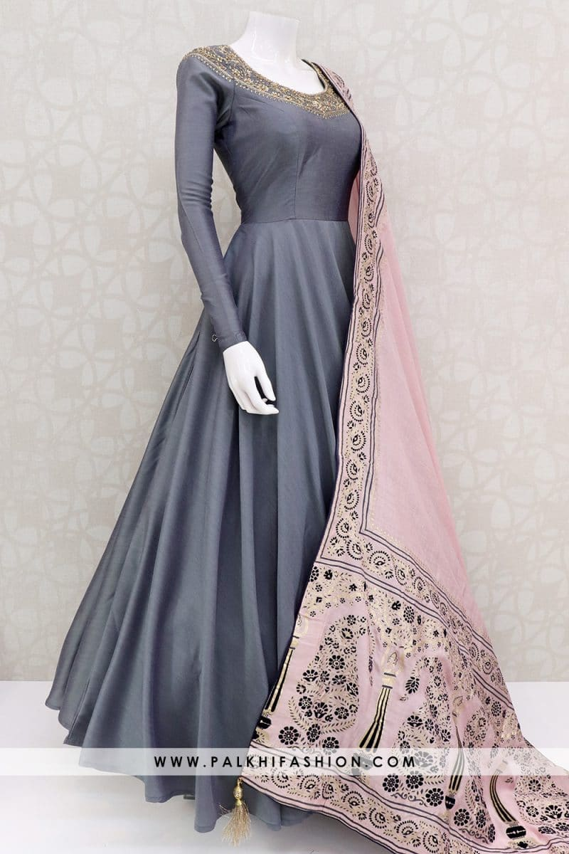 Deep grey silk indian outfit featuring petite stone,cutdana & kundan work.Contrast light pink soft art silk dupatta with applique & embroidery work