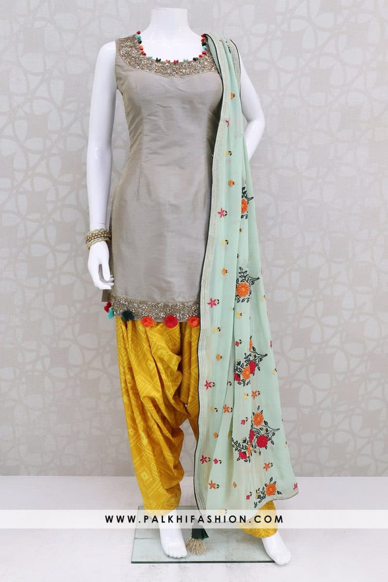 Light grey soft silk palazzo suit from palkhi fashion with silk embroidery,embossed,kundan work.light yellow patiala pants & sea green georgette dupatta