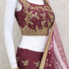 Palkhi fashion exclusive full flair wine colored designer lehenga choli with petite stones,kundan,zardosi & cutdana work.Handworked blouse with net duppata