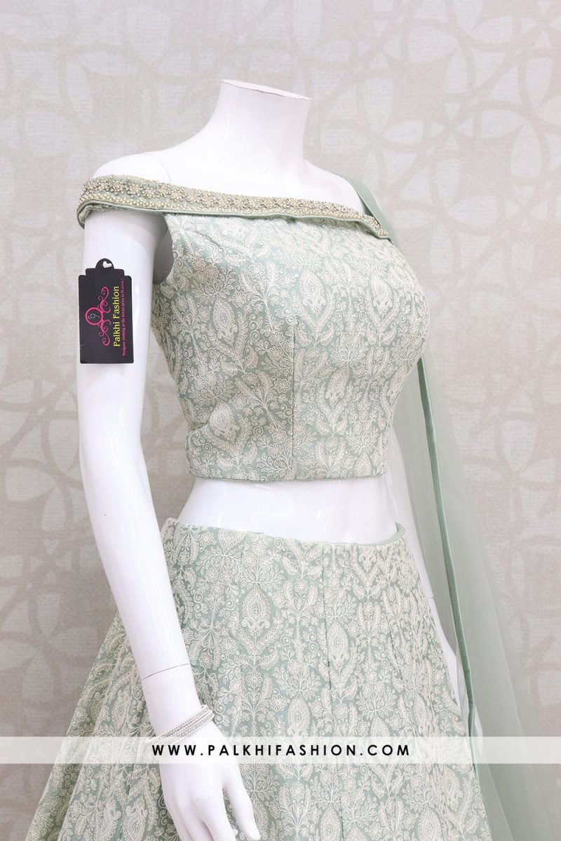 Palkhi fashion exclusive light sea green soft silk designer lehenga choli with lakhnavi work,thread embroidery.off shoulder blouse done with kundan work