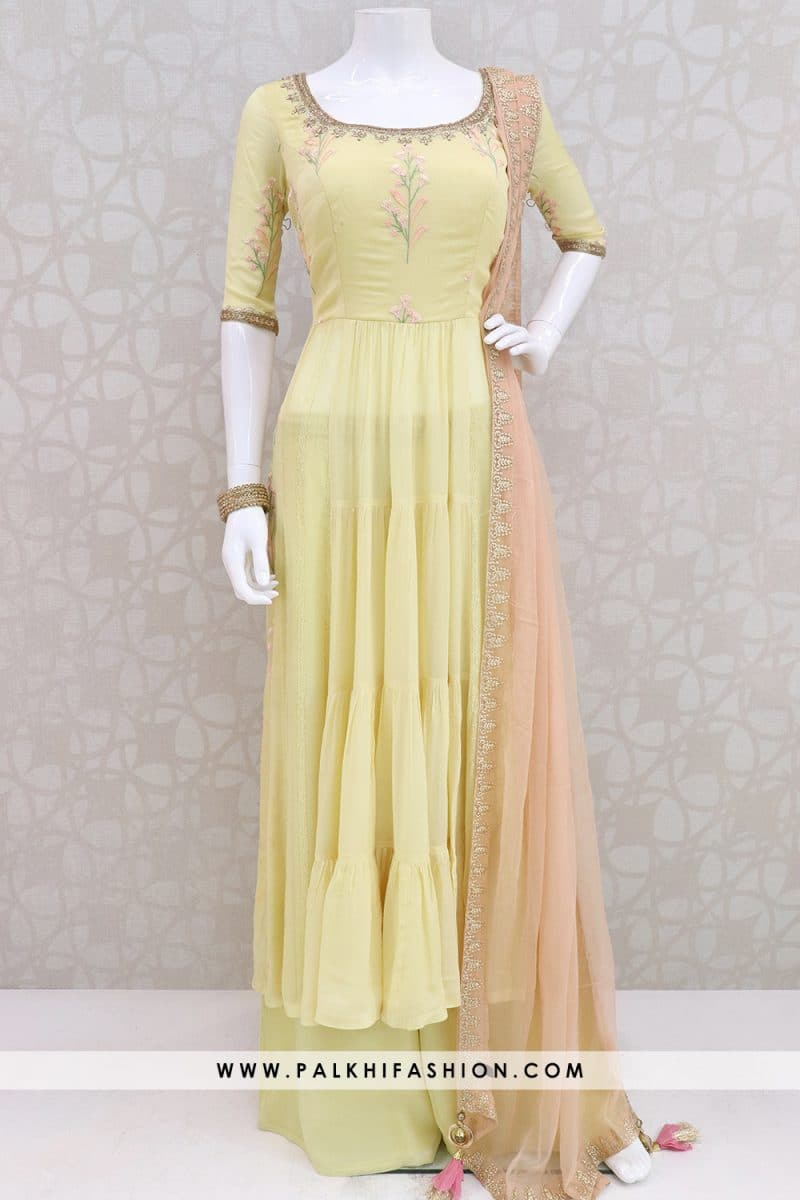 Pastel yellow pure chiffon palazzo suit from palkhi fashion.resham embroidery & kundan work.Splitted flare with palazzo pants & light peach chiffon dupatta