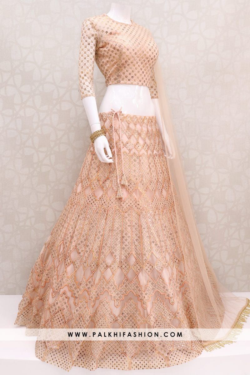 Light coral soft net designer lehenga choli from palkhi fashion with attractive thread,resham,petite stone & cut work.Matching blouse & soft net dupatta