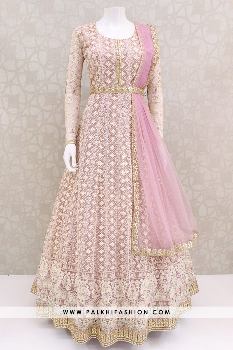 Light pink soft net indian outfit from palkhi fashion.Beautify with lakhnavi & gota work.Dupatta is attached.Trendy style with elegant work.