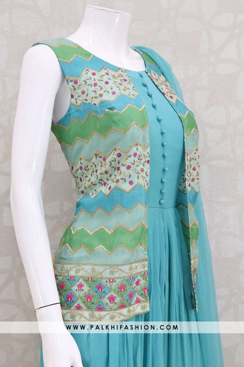 Palkhi fashion presents pastel blue georgette suit with self embroidery,resham & golden thread work.Georgette pleats from the waist making it look modern