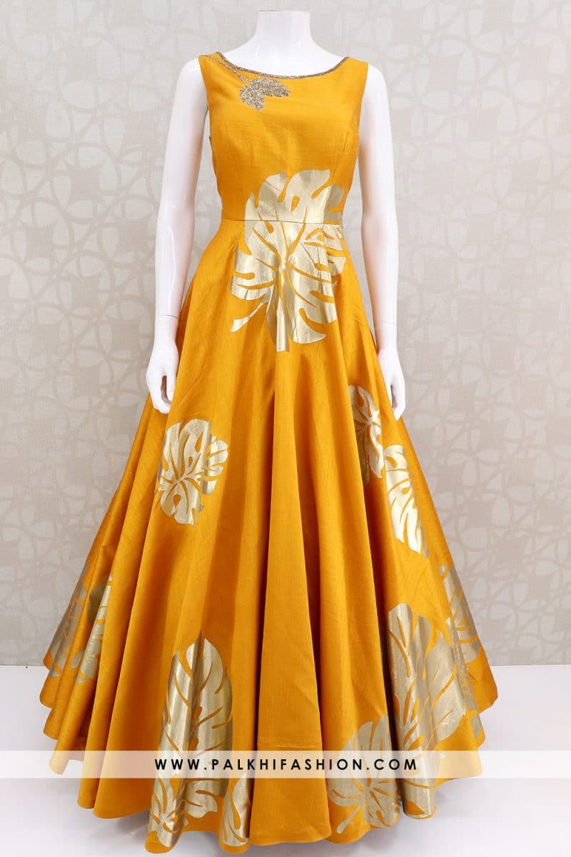 golden yellow soft raw silk indian designer outfit from palkhi fashion featuring gold applique,petite stone,cutdana work highlighted with appealing pattern